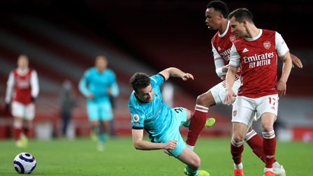 Liverpool's Diogo Jota (centre) and Arsenal's Gabriel Magalhaes (second right) battle for the ball d