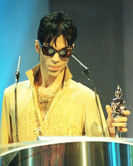 The Artist Formerly Known As Prince receivinghis BRIT award in 1995
