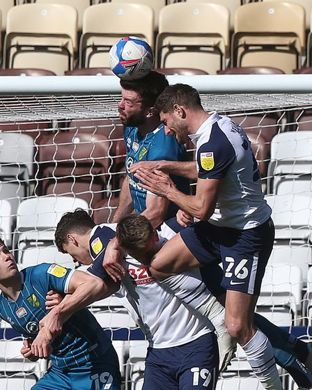 Grant Hanley of Norwich heads clear during the Sky Bet Championship match at Deepdale, Preston