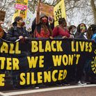 Black Lives Matter protesters hold a banner outside Buckingham Palace, April 3, 2021