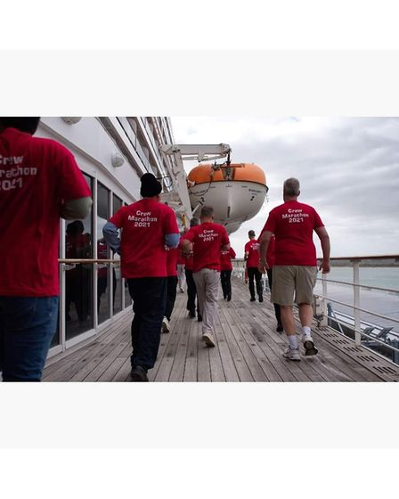 The crew of Queen Mary 2 during their marathon fundraiser.