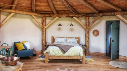 The inside of a luxury yurt at Round the Woods glamping