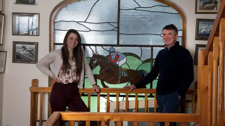 Jimmy Frost and daughter Bryonywith the stained glass window Jimmy had made when he built his house