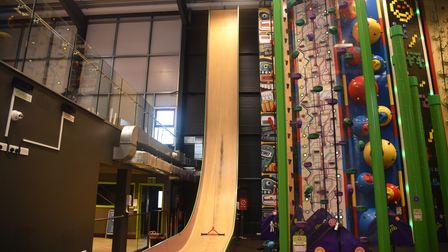 Large wooden drop slide and climbing wall at Clip 'n Climb in Ipswich