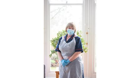 Hospice at Home nurse in uniform and full PPE gear