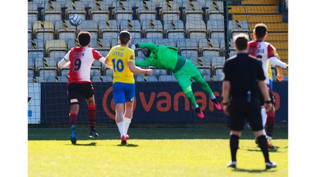 Lucas Covolan, Goalkeeper of Torquay United makes a save during the National League match between To