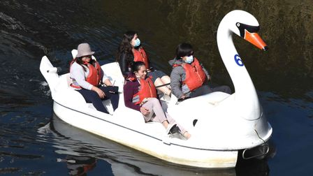 A family enjoying a cruise on a swan boat
