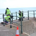 The railings along the seafront have been repainted