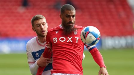 Nottingham Forest's Lewis Grabban and Queens Park Rangers' Sam Field battle for the ball at the City Ground
