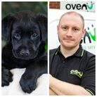 Black labrador guide dog pup with sponsor