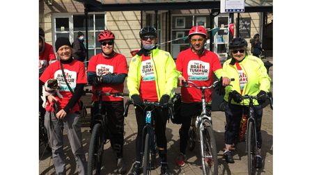 Group of cyclists with helmets on charity bike ride