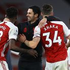 Arsenal manager Mikel Arteta (centre) celebrates with Thomas Partey (left) and Granit Xhaka after th