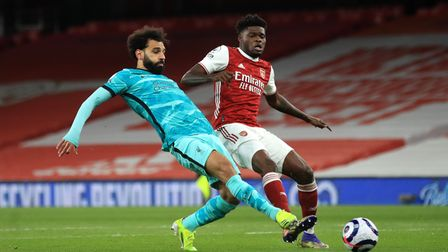 Liverpool's Mohamed Salah (left) and Arsenal's Thomas Partey (right) battle for the ball during the