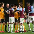 West Ham United's Jesse Lingard (11) and Wolverhampton Wanderers' Pedro Neto (7) clash during the Pr