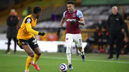 West Ham United's Jesse Lingard (right) and Wolverhampton Wanderers' Nelson Semedo in action during