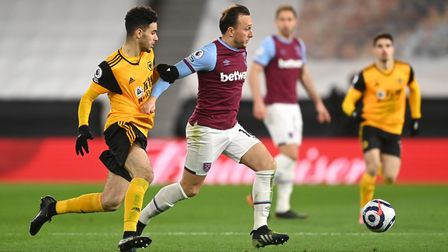 Wolverhampton Wanderers' Rayan Ait-Nouri (left) and West Ham United's Mark Noble battle for the ball