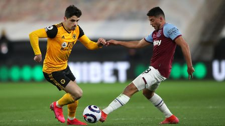 Wolverhampton Wanderers' Pedro Neto (left) and West Ham United's Pablo Fornals battle for the ball d