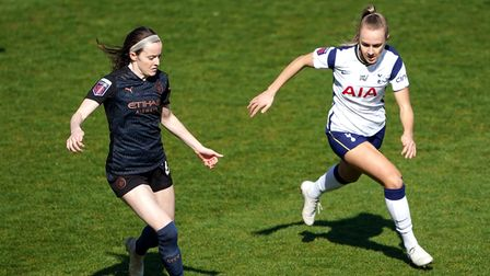 Manchester City's Rose Lavelle (left) and Tottenham Hotspur's Josie Green battle for the ball during