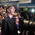 Jacob Rees Mogg smiles for the camera during a fringe event to discuss Brexit during the Conservative Party conference