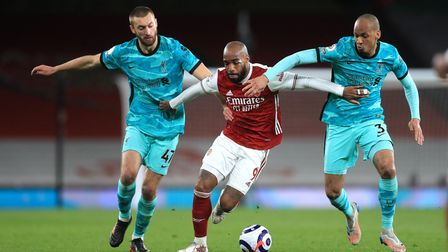 Liverpool's Nathaniel Phillips (left) and Fabinho (right) battle for the ball with Arsenal's Alexand