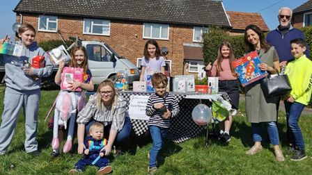 Lana (right),10, with egg hunt attendees and raffle prizes