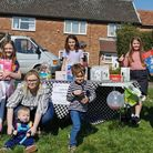 Lana (right), 10, with egg hunt attendees and raffle prizes
