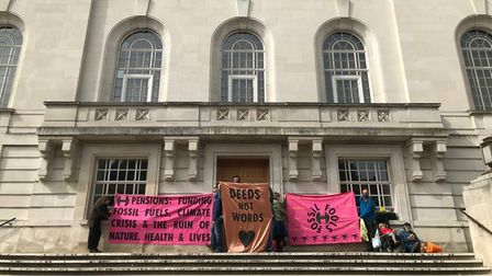 Climate campaigners hold banner at Hackney Town Hall