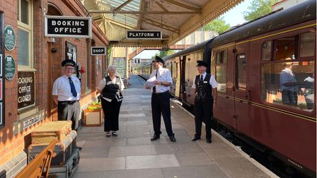 GWSR station staff enjoy a joke at Toddington