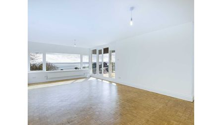 The large open-plan lounge/dining area has double doors leading onto private patio/terrace area with amazing sea views