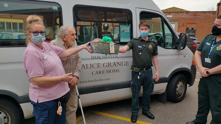 Alan and staff from the care home hand over their thanks to frontline workers