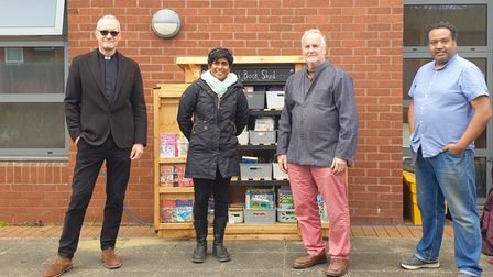 The New Greens Book Shed team with John Mole (third from left).