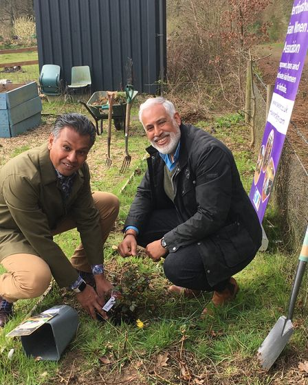 Dee and Ash Chury planting a tree in memory of their mother,Vasanti Chury.