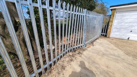 A fence has been damaged during an incident of fly-tipping in Valley Way, Stevenage