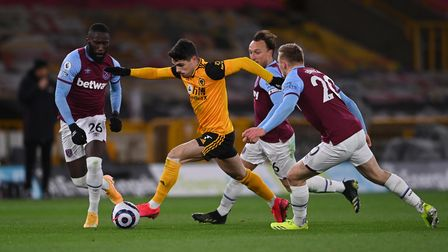 Wolverhampton Wanderers' Pedro Neto (centre) in action with West Ham United's Arthur Masuaku (left),