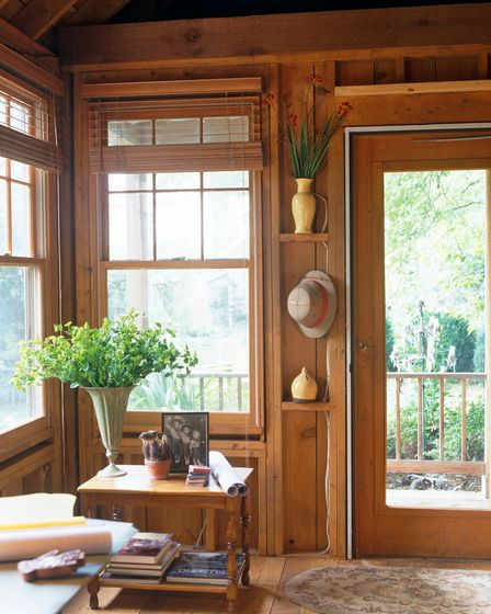 Pictures and vases will help give your garden office the personal touch.