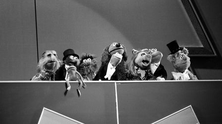The Muppets, including Miss Piggy, in song