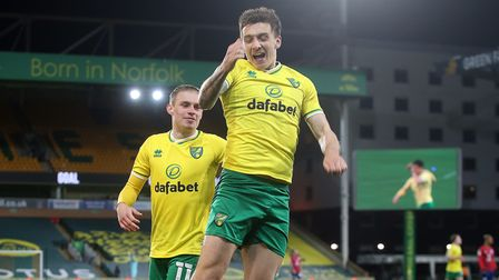 Jordan Hugill completes a 7-0 Championship romp for Norwich City against Huddersfield Town