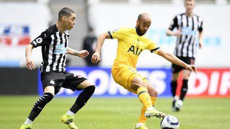 Newcastle United's Miguel Almiron and Tottenham Hotspur's Lucas Moura (right) battle for the ball du