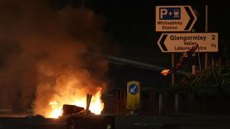 Bins are set ablaze at the Cloughfern roundabout in Newtownabbey
