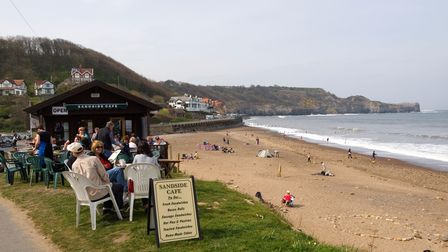 Busy Sandside Cafe by the beach at Sandsend near Whitby North Yorkshire