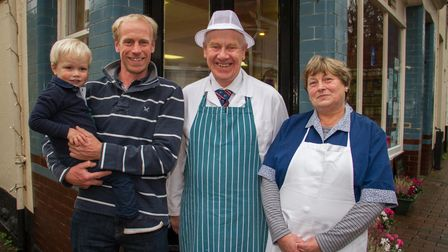 Stewart and Shirley Hayman with son Mark and grandson James outside their shop. Ref shs 48 19TI 5058