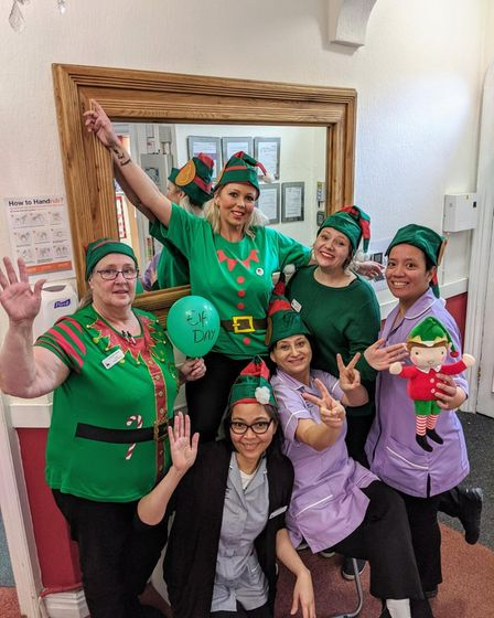 Danielle Bullant with other staff members of Laurel Lodge dressed as elves celebrating Christmas