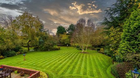 The welcoming family home is surrounded by farmland and set amongst 2.5 acres of lovely gardens.