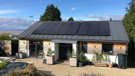Front of the eco house in Down Road, Portishead. Solar-panels on roof, timer clad exterior and paved area in front.