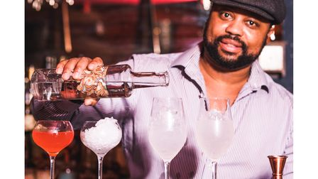 Kingdom Thenga pouring cocktails in his Chester bar, The Subrubs
