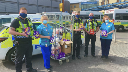 BTP officers hand over donated chocolate to staff at Queen's Hospital in Romford.