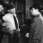 Private investigator Phil Marlowe (Humphrey Bogart) gets roughed-up in a scene from the 1946 film The Big Sleep