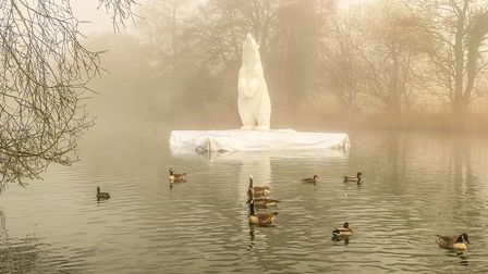 Adam Binder's 12ft two-tonne monumental bronze polar bear floating on an 'iceberg' in one of the lakes