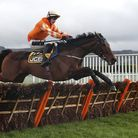 Fakir D'Oudairies ridden by JJ Slevin on their way to victory at Cheltenham Racecourse