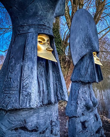 The Grandees by legendary British sculptor Philip Jackson features two operatic figures sitting on a bench